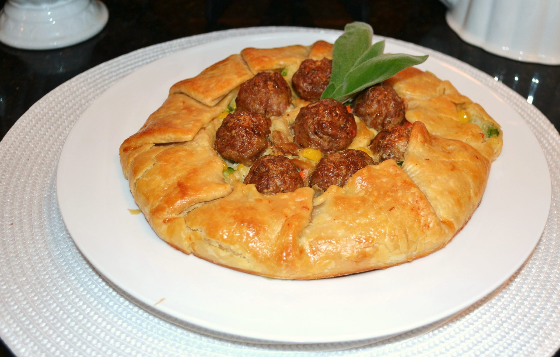 Winter- Rustic chicken pot pie with sage garnish
