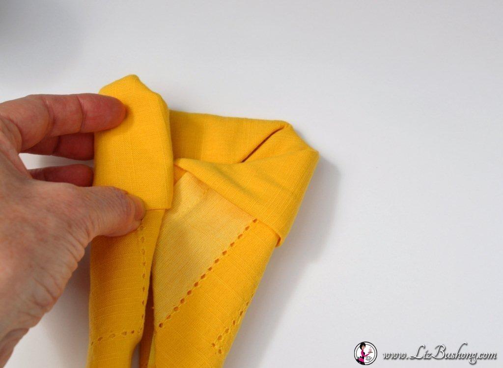 Bunny Ears napkin fold-step 18-www.lizbushong.com