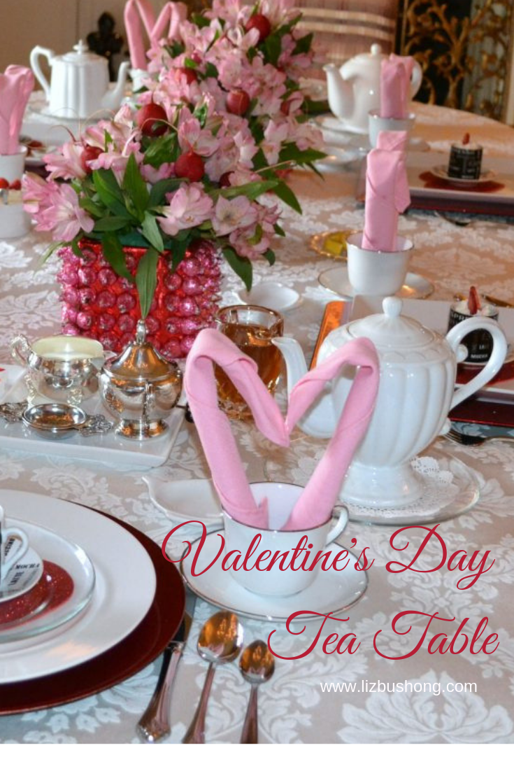 lizbushong.com Valentine Tea Table Scape, Simple, easy table setting featuring heart shaped napkin fold, pink kissed centerpiece, tea and pots de creme for dessert. Get Recipe and how to fold instructions here.