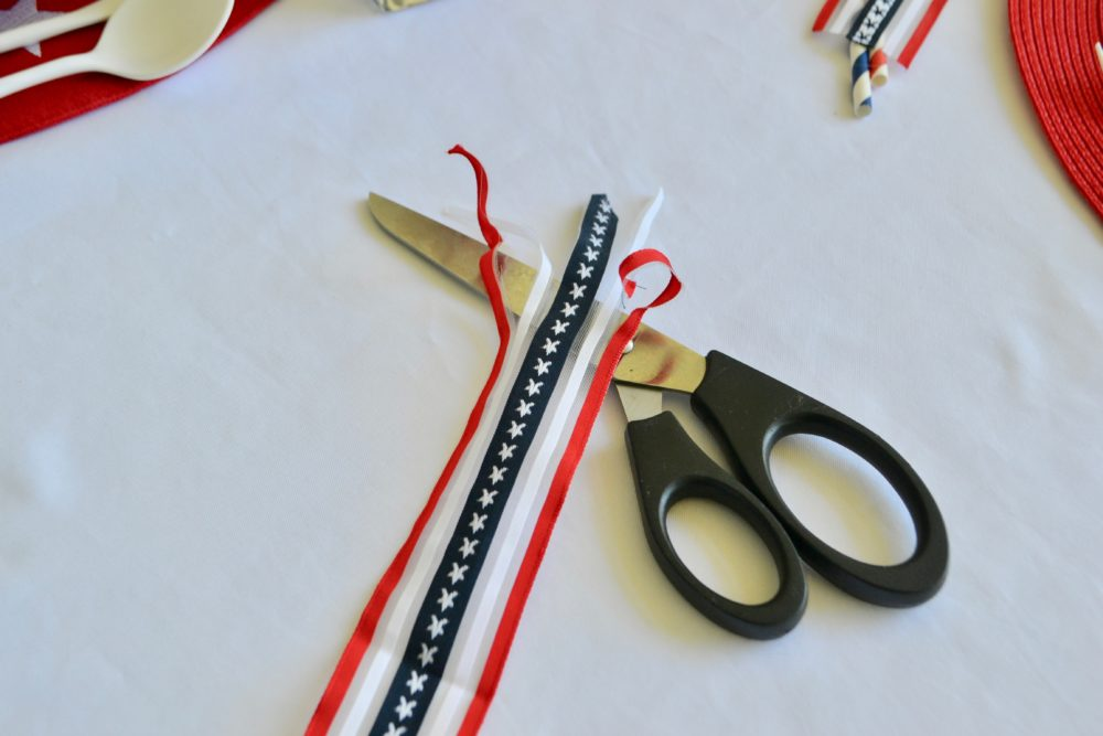 DIY Firecracker napkin fold for 4th of July table.